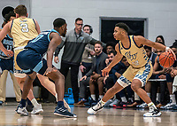 WASHINGTON, DC - FEBRUARY 8: Jameer Nelson Jr. #12 of George Washington holds the ball away from Cyril Langevine #10 of Rhode Island during a game between Rhode Island and George Washington at Charles E Smith Center on February 8, 2020 in Washington, DC.