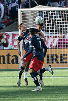 FOXBOROUGH, MA - MARCH 7: Justin Rennicks #12 of New England Revolution competes with Johan Kappelhof #4 of Chicago Fire for a high ball during a game between Chicago Fire and New England Revolution at Gillette Stadium on March 7, 2020 in Foxborough, Massachusetts.