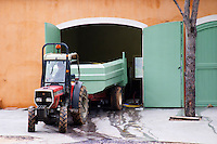 Tractor delivering grapes to the winery. Domaine Haut-Lirou in St Jean de Cuculles. Pic St Loup. Languedoc. France. Europe.