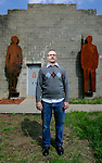 "Artist Andy Miller (Cq), a sculptor, in front of his studio, where two welded steel sculptures, part of a collection called ""The Scale,""  hang outside, in Denver on April 17, 2007.   (ELLEN JASKOL/ROCKY MOUNTAIN NEWS).***Andy Miller (cq)"