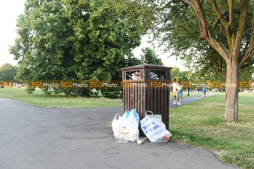 Rubbish bins overflowing with litter at Primrose Hill during the coronavirus pandemic
