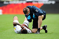 Rhian Brewster of Swansea City receives treatment during the Sky Bet Championship match between Swansea City and Sheffield Wednesday at the Liberty Stadium in Swansea, Wales, UK. Sunday 05 July 2020