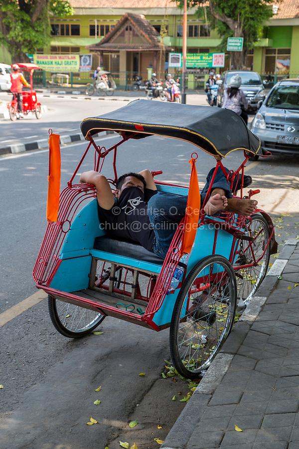 Yogyakarta, Java, Indonesia.  Becak Driver Resting.