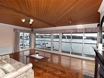 As would be expected with a boatbuilder's house, copious use is made of quality hardwood, as seen here in the first floor living room.