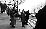 Pedestrians wait at a crosswalk in Madrid, Spain. Feb. 20, 2009.