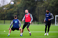 Mike van der Hoorn (centre) of Swansea City in action during the Swansea City Training at The Fairwood Training Ground on October 16, 2018 in Swansea, Wales, UK. Tuesday 16 October 2018