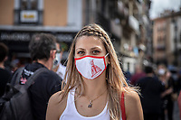 PAMPLONA, SPAIN - July 06: A woman wearing a mask with an image of San Fermin Saint stands in the Old Town where the ''txupinazo'' would usually take place to start the famous San Fermin festival, which was canceled this year by the conoravirus. In Pamplona, July 06, 2020 (Photo by Maite H. Mateo /VIEWpress via Getty Images)