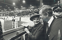 Front-row seat at the Royal. Governor-General Jeanne Sauve had a front-row seat at the Royal Agricultural Winter Fair yesterday when the cream of North American cattle strutted their stuff before a large crowd at the CNE Coliseum. Explaining the finer points of the competition is her host, John Craig Eaton, president of the fair. Eaton accompanied Sauve as she spent the morning viewing exhibits.<br /> <br /> Photo : Boris Spremo - Toronto Star archives - AQP