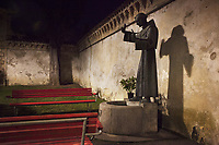 Switzerland. Canton Ticino. Lugano.  A bronze statue of Saint Francis of Assisi at nighttime outside the Church « Santa Maria di Loreto ». Saint Francis of Assisi (Italian: San Francesco d'Assisi), born Giovanni di Pietro di Bernardone, informally named as Francesco (1181/1182 – 3 October 1226),who was an Italian Catholic friar, deacon and preacher. He founded the men's Order of Friars Minor, the women's Order of Saint Clare, the Third Order of Saint Francis and the Custody of the Holy Land. Francis is one of the most venerated religious figures in history. 14.03.2018 © 2018 Didier Ruef