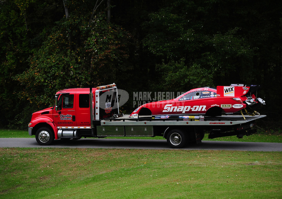 Oct. 1, 2011; Mohnton, PA, USA: The body from the car of NHRA funny car driver Cruz Pedregon is towed back to the pits during qualifying for the Auto Plus Nationals at Maple Grove Raceway. Mandatory Credit: Mark J. Rebilas-