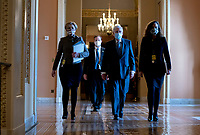 Senate Minority Leader Mitch McConnell, a Republican from Kentucky, center, wears a protective mask while walking to the Senate Chamber at the U.S. Capitol in Washington, D.C., U.S., on Tuesday, Feb. 9, 2021. The Senate begins Donald Trump's second impeachment trial today with a fight over whether the proceeding is constitutional, as a number of conservative lawyers reject the defense team's claim that a former president can't be convicted of a crime by Congress.<br /> CAP/MPI/RS<br /> ©RS/MPI/Capital Pictures
