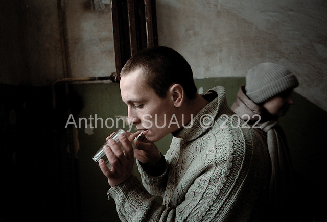 Tolyatti, Russia..Heroine addict Jenya, 24 years old prepares to shoot up.