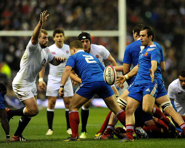 Morgan Parra of France sends up a box kick as Joe Marler of England (left) attempts to block it during the RBS 6 Nations match between England and France at Twickenham on Saturday 23rd February 2013 (Photo by Rob Munro)