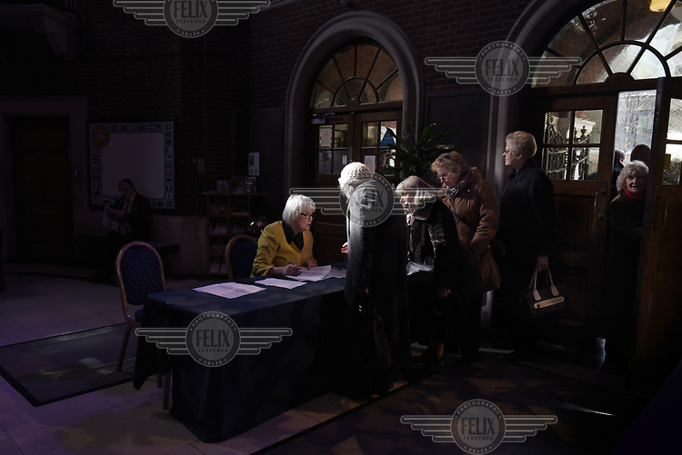 Members of UKIP arrive for a speech by Nigel Farage on immigration at the Emmanuel Centre in Westminster, London during campaigning for the 7 May 2015 general election.