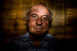 "Yvon Chouinard, founder of Patagonia, at his Jackson, Wyoming home.  Chouinard, an avid climber and outdoorsman, describes himself as a natural innovator and a reluctant businessman.  Patagonia's ""slow business"" model is unique in that it encourages responsible growth and has a built in 'tithe' system that returns 1% of its net sales to environmental causes.  The company also pays employees to work full-time on environmental issues."
