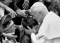 1984 FILE PHOTO - ARCHIVES -<br /> <br /> A kiss from a Pope, A young Indian boy is embraced by Pope John Paul II during the pontiff's visit to the world-famous shrine of Ste. Anne de Beaupre near Quebec city. About 4.000 Indians and inuit heard the Pope tell them that Canada's native people must become architects of your own future.<br /> <br /> 1984<br /> <br /> PHOTO : Boris Spremo - Toronto Star Archives - AQP