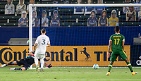 CARSON, CA - OCTOBER 07: Yimmi Chara #23 of the Portland Timbers  scores a goal past David Bingham #1 GK of the Los Angeles Galaxy during a game between Portland Timbers and Los Angeles Galaxy at Dignity Heath Sports Park on October 07, 2020 in Carson, California.