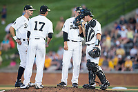 Wake Forest Demon Deacons starting pitcher Parker Dunshee (36) has a chat with catcher Ben Breazeale (39) as shortstop Bruce Steel (17) and second baseman Jake Mueller (6) look on during the game against the West Virginia Mountaineers in Game Four of the Winston-Salem Regional in the 2017 College World Series at David F. Couch Ballpark on June 3, 2017 in Winston-Salem, North Carolina.  The Demon Deacons walked-off the Mountaineers 4-3.  (Brian Westerholt/Four Seam Images)