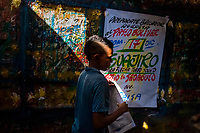 "A Colombian sign painter apprentice folds over a just-finished music party poster in the sign painting workshop in Cartagena, Colombia, 12 December 2017. Hidden in the dark, narrow alleys of Bazurto market, a group of dozen young men gathered around José Corredor (""Runner""), the master painter, produce every day hundreds of hand-painted posters. Although the vast majority of the production is designed for a cheap visual promotion of popular Champeta music parties, held every weekend around the city, Runner and his apprentices also create other graphic design artworks, based on brush lettering technique. Using simple brushes and bright paints, the artisanal workshop keeps the traditional sign painting art alive."