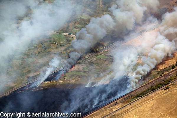 aerial photograph of a grass fire near railroad lines in Contra Costa County, California