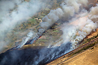 aerial photograph of a grass fire near railroad lines in Contra Costa County, California