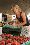 Lewisburg Farmers Market. Jennifer Novinger selecting fresh strawberries.