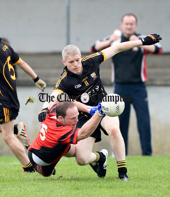Pat Coffey of Clondegad in action against Sean Mc Mahon of Coolmeen during the Junior A championship final at Cooraclare. Photograph by John Kelly.