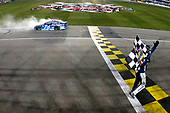 Monster Energy NASCAR Cup Series<br /> Go Bowling 400<br /> Kansas Speedway, Kansas City, KS USA<br /> Saturday 13 May 2017<br /> Martin Truex Jr, Furniture Row Racing, Auto-Owners Insurance Toyota Camry celebrates his win <br /> World Copyright: Russell LaBounty<br /> LAT Images<br /> ref: Digital Image 17KAN1rl_5887