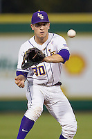 LSU Tigers shortstop Alex Bregman #30 makes a catch Auburn Tigers in the NCAA baseball game on March 22nd, 2013 at Alex Box Stadium in Baton Rouge, Louisiana. LSU defeated Auburn 9-4. (Andrew Woolley/Four Seam Images).