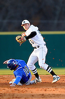 Second baseman Daniel Seeba (5) of the University of South Carolina Upstate Spartans makes the putout against Pete Guy (10) of the UNC Asheville Bulldogs on Tuesday, March, 25, 2014, at Cleveland S. Harley Park in Spartanburg, South Carolina. (Tom Priddy/Four Seam Images)
