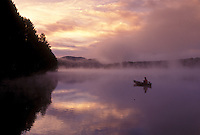 canoeing, canoe, sunset, sunrise, Vermont, VT, Woman paddling a canoe on Mollys Falls Pond at sunrise in the fog.