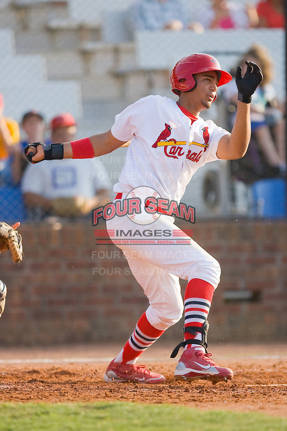 David Medina #22 of the Johnson City Cardinals follows through on his swing against the Elizabethton Twins at Howard Johnson Field July 3, 2010, in Johnson City, Tennessee.  Photo by Brian Westerholt / Four Seam Images