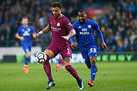 Kyle Walker of Manchester City is marked by Junior Hoilett of Cardiff City during the Fly Emirates FA Cup Fourth Round match between Cardiff City and Manchester City at the Cardiff City Stadium, Wales, UK. Sunday 28 January 2018