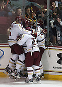 Steven Santini (BC - 6), Chris Calnan (BC - 11), Quinn Smith (BC - 27) - The Boston College Eagles defeated the visiting University of Wisconsin Badgers 9-2 on Friday, October 18, 2013, at Kelley Rink in Conte Forum in Chestnut Hill, Massachusetts.