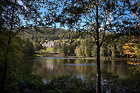 View of the house from across one of two lochs (lakes) created by designer W.S Gilpin in 1832