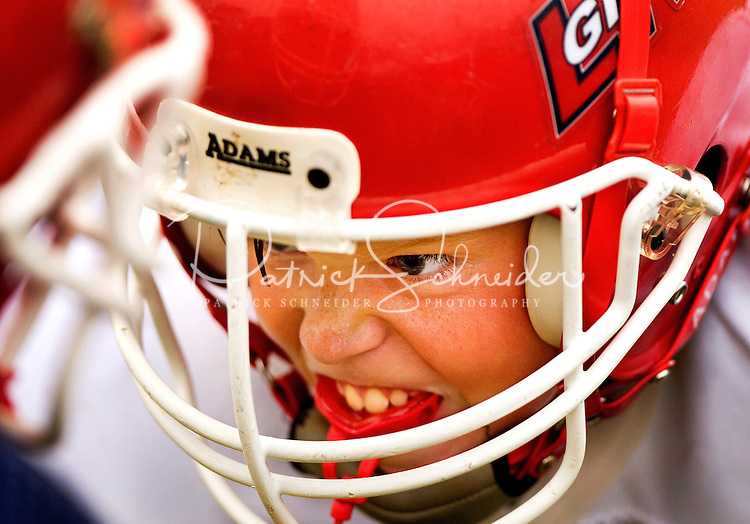 In fall 2009, boys from around Lake Norman, NC, north of Charlotte, pulled on helmets and strapped on pads to play American football, one of the country's most popular sports. The Pop Warner football league has been helping youngsters play the sport since 1929. Photo is part of a series of images documenting one team of North Carolina boys learning and playing the sport in Cornelius, NC in fall 2009. They're playing in the Lake Norman Giants league.