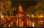 Church and canal in Amsterdam at night, Holland.