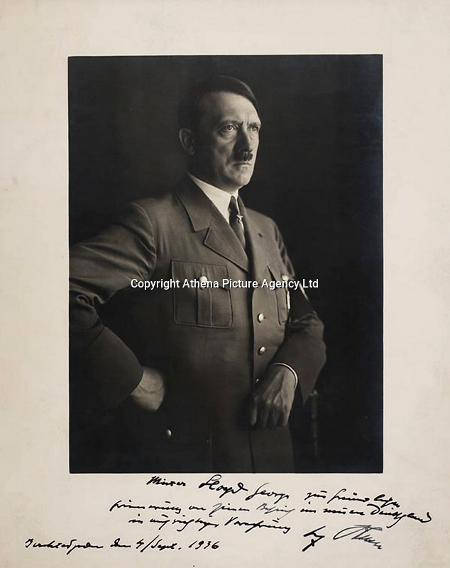 """Pictured: <br /> Re: A photo, signed by Adolf Hitler which was given by the Nazi leader himself to former Prime Minister David Lloyd George is to be sold at auction with an estimate between £15,000 and £20,000.<br /> Tt was discovered in items owned by a London bookdealers who passed away.<br /> The photo is dated September 4 1936 and was given to George when he visited Hitler at his Bavarian Alps residence, known as Berghof during the the decade in which Lloyd George was said to be pro-German.<br /> The print is inscribed: """"Mister Lloyd George, zur freundlichen Erinnerung an seinen Beitrag in meinen Deutschland in umsichtiger Vorahnung, Adolf Hitler, Berchtesgaden den 4 /Sept. 1936.""""<br /> Which translates to:  """"Mister Lloyd George, in kind remembrance of his contribution to my Germany with circumspect presentiment, Adolf Hitler, Berchtesgaden, 4th September 1936.""""<br /> Auctioneer Chris Albury said: """"This is one of the most historically charged autograph items we have ever handled in 30 years.<br /> """"It is mind-boggling to us now to think that the meeting between David Lloyd George and Adolf Hitler ever took place at all.""""<br /> The photograph will be auctioned at Dominic Winter Auctioneers in Gloucestershire on November 9."""