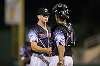 Kannapolis Intimidators relief pitcher Ian Hamilton (12) shakes hands with catcher Seby Zavala (21) after closing out the win over the Delmarva Shorebirds at Kannapolis Intimidators Stadium on June 25, 2016 in Kannapolis, North Carolina.  The Intimidators defeated the Shorebirds 2-1.  (Brian Westerholt/Four Seam Images)