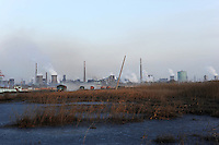 Lorries pass heavy industrial plants in the northern industrial city of Baotou, Inner Mongolia. The city is one of China's most polluted due to the proliferation of petro chemical,chemical and heavy industrial plants.