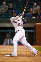 Chattanooga Lookouts third baseman Miguel Sano (24) hits a home run during a game against the Jacksonville Suns on April 30, 2015 at AT&T Field in Chattanooga, Tennessee.  Jacksonville defeated Chattanooga 6-4.  (Mike Janes/Four Seam Images)