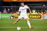 Cristiano Ronaldo (7) of Real Madrid shoots and scores his second goal. Real Madrid defeated A. C. Milan 5-1 during a 2012 Herbalife World Football Challenge match at Yankee Stadium in New York, NY, on August 8, 2012.