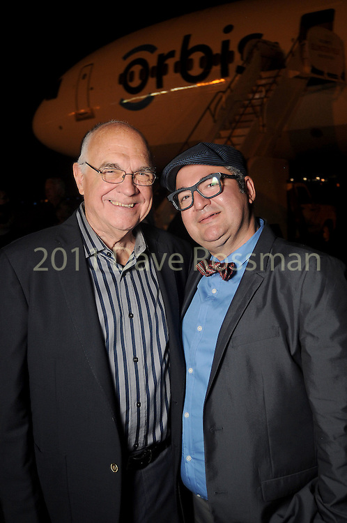 John Heinzerling and Ciro Flores at a welcome reception for the Orbis Flying Eye Hospital at Ellington Airport Tuesday Oct. 20,2015.(Dave Rossman photo)