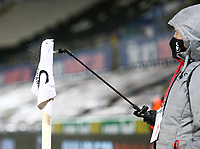 19th December 2020; Liberty Stadium, Swansea, Glamorgan, Wales; English Football League Championship Football, Swansea City versus Barnsley; Corner flag is sprayed with disinfectant after the game following Covid-19 procedures