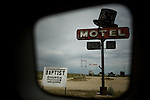 Travel scenes of Wyoming through the window of a rented Mazda M5...A motel in Jeffery City, a ghost town left empty by the closure of a Uranium mine in the mid 80s.