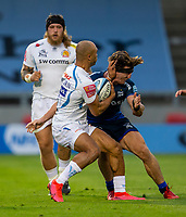 21st August 2020; AJ Bell Stadium, Salford, Lancashire, England; English Premiership Rugby, Sale Sharks versus Exeter Chiefs; Olly Woodburn of Exeter Chiefs hands off Tom Curry of Sale Sharks