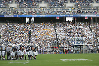 """State College, PA - 11/02/2013:  The gold ribbon block for THON is visible next to the """"S"""" block in the PSU student section.  Penn State defeated Illinois by a score of 24-17 in overtime on Saturday, November 2, 2013, at Beaver Stadium.<br /> <br /> Photos by Joe Rokita / JoeRokita.com"""