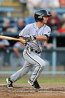 Kannapolis Intimidators third baseman Michael Johnson #5 swings at a pitch during a game against the Asheville Tourists at McCormick Field on May 9, 2013 in Asheville, North Carolina. The Intimidators won the game 13-12. (Tony Farlow/Four Seam Images).
