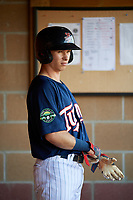 Elizabethton Twins second baseman Michael Helman (13) in the dugout during a game against the Bristol Pirates on July 28, 2018 at Joe O'Brien Field in Elizabethton, Tennessee.  Elizabethton defeated Bristol 5-0.  (Mike Janes/Four Seam Images)