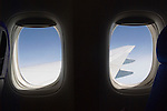Window seat looking out of airplane window. Air travel